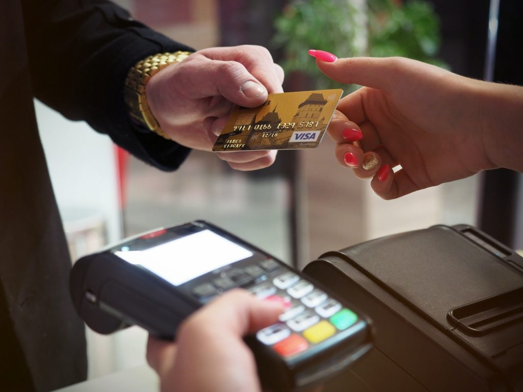 Image of a male paying for something on his card.
